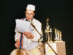Tim Walker reads off the rules to the competitors.
